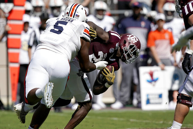 Auburn defensive tackle Derrick Brown (5) tackles Texas A&M running back Jacob Kibodi (23) for a loss during the first half of an NCAA college football game, Saturday, Sept. 21, 2019, in College Station, Texas. (AP Photo/Sam Craft)