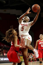 Maryland guard Kaila Charles (5) goes up for a shot against Ohio State forward Aaliyah Patty during the second half of an NCAA college basketball game, Monday, Jan. 6, 2020, in College Park, Md. Maryland won 72-62. (AP Photo/Julio Cortez)