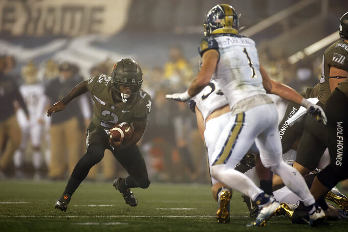Army quarterback Tyhier Tyler rushes during the second half of an NCAA college football game Saturday, Dec. 12, 2020, in West Point, N.Y.  (AP Photo/Adam Hunger)