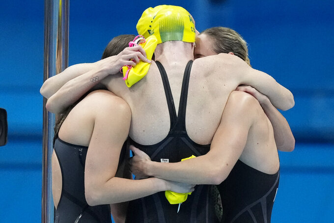 The team from Australia celebrates after winning the final of the women's 4x100m freestyle relay at the 2020 Summer Olympics, Sunday, July 25, 2021, in Tokyo, Japan. (AP Photo/Charlie Riedel)