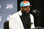 FILE - In this April 25, 2019, file photo, Clemson defensive tackle Christian Wilkins speaks at a press conference after the Miami Dolphins selected Wilkins in the first round of the NFL Draft, in Nashville, Tenn. Clemson's defense was a big reason why the Tigers won a second national championship in three seasons. Now that unit has massive holes to fill after losing its entire front to the NFL, along with three key linebackers and two members of the secondary _ and that could mean the Tigers have to win shootouts behind quarterback Trevor Lawrence to stay on top.(AP Photo/Vera Nieuwenhuis, File)