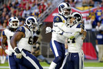 Los Angeles Rams safety Taylor Rapp, right, celebrates his interception against the Arizona Cardinals in for a touchdown with free safety Eric Weddle and defensive tackle Sebastian Joseph-Day, left, during the second half of an NFL football game, Sunday, Dec. 1, 2019, in Glendale, Ariz. (AP Photo/Rick Scuteri)