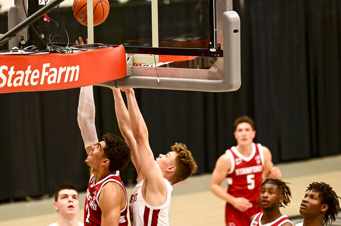 Stanford forward Jaiden Delaire (11) attempts a shot as Washington State forward Aljaz Kunc (4) defends during the first half of an NCAA college basketball game, Saturday, Feb. 20, 2021, in Pullman, Wash. (AP Photo/Pete Caster)