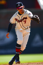 Atlanta Braves shortstop Dansby Swanson (7) makes an error as he bobbles a line drive hit by San Francisco Giants' Kevin Pillar during the sixth inning of a baseball game Sunday, Sept. 22, 2019, in Atlanta. (AP Photo/John Amis)