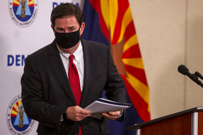 Governor Doug Ducey leaves the podium after a press conference regarding the COVID-19 pandemic at the Arizona National Guard headquarters on Aug. 20, 2020, at Papago Park Military Reservation in Phoenix. (Sean Logan/The Arizona Republic via AP)