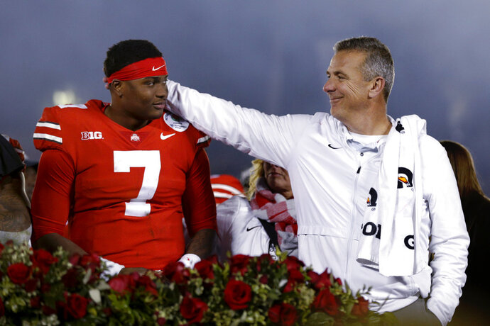 Ohio State coach Urban Meyer, right, celebrates with quarterback Dwayne Haskins after Ohio State defeated Washington 28-23 in the Rose Bowl NCAA college football game Tuesday, Jan. 1, 2019, in Pasadena, Calif. (AP Photo/Jae C. Hong)