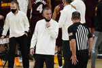 Arizona State head coach Bobby Hurley speaks with an official during the first half of an NCAA college basketball game against Oregon in the quarterfinal round of the Pac-12 men's tournament Thursday, March 11, 2021, in Las Vegas. (AP Photo/John Locher)