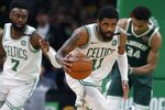 FILE - In this May 6, 2019, file photo, Boston Celtics' Kyrie Irving (11) brings the ball upcourt during the second half of Game 4 of a second-round NBA basketball playoff series against the Milwaukee Bucks in Boston. Irving and Kevin Durant gave the Brooklyn Nets two big victories in one night. In the first hours of free agency, the team added two of the best players available to a young roster that made the playoffs, giving them hope of not only contention for an NBA title, but to be the biggest basketball team in New York. (AP Photo/Michael Dwyer, File)