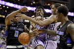 Saint Louis' Jordan Goodwin (0) and Jimmy Bell Jr. (32) battle with Kansas State's Xavier Sneed, center left, and Levi Stockard III, center right, for the ball during the second half of an NCAA college basketball game Saturday, Dec. 21, 2019, in Kansas City, Mo. (AP Photo/Charlie Riedel)