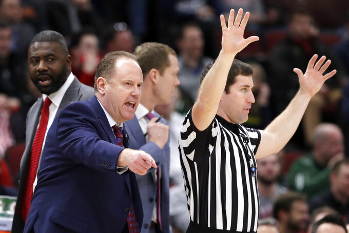 Wisconsin head coach Greg Gard argues a call during the second half of an NCAA college basketball game against Nebraska in the quarterfinals of the Big Ten Conference tournament, Friday, March 15, 2019, in Chicago. Wisconsin won 66-62. (AP Photo/Nam Y. Huh)