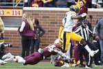 Iowa wide receiver Ihmir Smith-Marsette runs the ball into the end zone through the arms of Minnesota's defensive back Antonio Shenault during an NCAA college football game Saturday, Oct. 6, 2018, in Minneapolis. (AP Photo/Stacy Bengs)