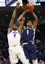 Butler forward Jordan Tucker, right, vies for a rebound against DePaul forward Paul Reed during the second half of an NCAA college basketball game Wednesday, Jan. 16, 2019, in Chicago. Butler won 87-69. (AP Photo/Nam Y. Huh)