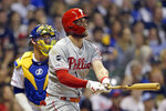 Philadelphia Phillies' Bryce Harper watches his RBI double during the fifth inning of the team's baseball game against the Milwaukee Brewers on Friday, May 24, 2019, in Milwaukee. (AP Photo/Aaron Gash)