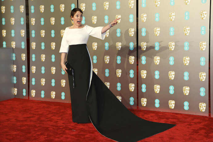 Actress Olivia Colman poses for photographers upon arrival at the BAFTA awards in London, Sunday, Feb. 10, 2019. (Photo by Vianney Le Caer/Invision/AP)