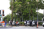 Police redirect traffic from the Makalapa Gate entrance to Joint Base Pearl Harbor-Hickam, Wednesday, Dec. 4, 2019, in Honolulu, following a shooting at Pearl Harbor naval shipyard. (AP Photo/Marco Garcia)