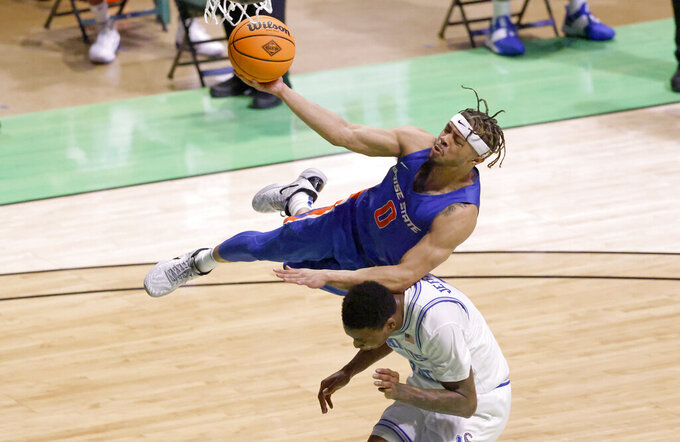 Boise State guard Marcus Shaver Jr., top, goes up for a layup and collides with Memphis forward D.J. Jeffries during the first half of an NCAA college basketball game in the semifinals of the NIT, Thursday, March 25, 2021, in Denton, Texas. (AP Photo/Ron Jenkins)