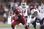 Washington State wide receiver Travell Harris (5) runs with the ball while pursued by New Mexico State defensive back Rodney McGraw II (21) during the first half of an NCAA college football game in Pullman, Wash., Saturday, Aug. 31, 2019. (AP Photo/Young Kwak)