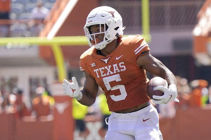 Texas running back Bijan Robinson (5) runs for a touchdown against Texas Tech during the second half of an NCAA college football game on Saturday, Sept. 25, 2021, in Austin, Texas. (AP Photo/Chuck Burton)