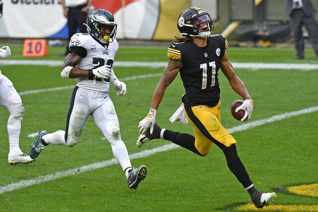 Pittsburgh Steelers wide receiver Chase Claypool (11) scores his fourth touchdown of an NFL football game, with Philadelphia Eagles free safety Rodney McLeod (23) defending, on a 35-yard pass play from quarterback Ben Roethlisberger during the second half in Pittsburgh, Sunday, Oct. 11, 2020. (AP Photo/Don Wright)