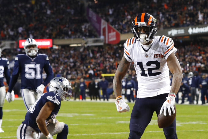 Chicago Bears' Allen Robinson (12) celebrates a touchdown reception during the first half of an NFL football game against the Dallas Cowboys, Thursday, Dec. 5, 2019, in Chicago. (AP Photo/Charles Rex Arbogast)