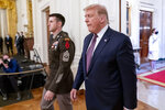 President Donald Trump and Army Sgt. Maj. Thomas P. Payne arrive for a Medal of Honor ceremony in the East Room of the White House, Friday, Sept. 11, 2020, in Washington. (AP Photo/Andrew Harnik)