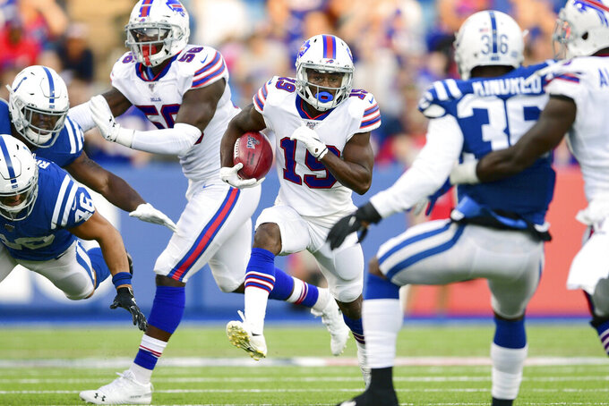 FILE - In this Aug. 8, 2019, file photo, Buffalo Bills' Isaiah McKenzie, center, runs the ball during the first half of an NFL preseason football game against the Indianapolis Colts, in Orchard Park, N.Y. With NFL cutdown day approaching, Bills receiver Isaiah McKenzie is confronted with the reality of his uncertain future each time he takes a seat at his locker.(AP Photo/David Dermer, File)