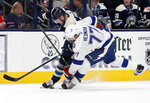 Columbus Blue Jackets forward Pierre-Luc Dubois, left, reaches for the puck against Tampa Bay Lightning defenseman Victor Hedman, of Sweden, during the second period of an NHL hockey game in Columbus, Ohio, Monday, Feb. 10, 2020. (AP Photo/Paul Vernon)