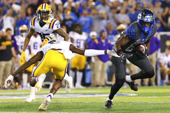 Kentucky tight end Isaiah Epps (81) tries to get away from an LSU defender during the first half of an NCAA college football game in Lexington, Ky., Saturday, Oct. 9, 2021. (AP Photo/Michael Clubb)