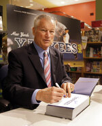 FILE - In this Wednesday, Oct. 7, 2009 file photo, Former New York Yankees pitcher Jim Bouton signs copies of the Associated Press book