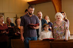 "This image released by Apple shows, front row from left, Justin Timberlake, Ryder Allen and June Squibb in a scene from ""Palmer."" (Apple via AP)"