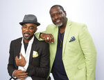 """This Aug. 27, 2019 photo shows portrait shows Ralph Tresvant, left, and Johnny Gill posing for a portrait in Los Angeles to promote Gill's eighth studio album """"Game Changer II."""