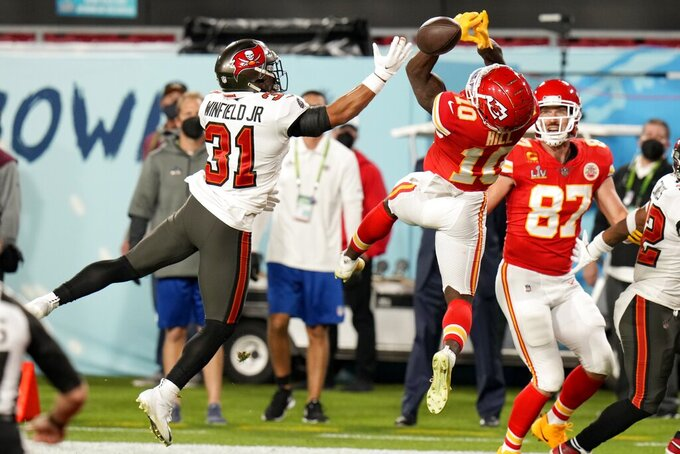 Tampa Bay Buccaneers strong safety Antoine Winfield Jr. (31) breaks up a pass intended for Kansas City Chiefs wide receiver Tyreek Hill (10) in the first half of the NFL Super Bowl 55 football game Sunday, Feb. 7, 2021, in Tampa, Fla. (AP Photo/Chris O'Meara)