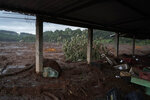 FILE - In this Jan. 26, 2019 file photo, mud covers a produce market after a Vale dam collapsed near Brumadinho, Brazil. It buried a Vale lunchroom, where hundreds of employees were believed to be eating, and also clobbered several other company buildings and parts of the city, including an inn. Authorities have recovered more than 120 bodies so far, and more than 200 people remain missing. (AP Photo/Leo Correa, File)