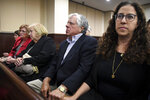Dan Markel's parents, Ruth and Phil Markel, and his sister Shelly Markel wait for the verdicts to be read for Katherine Magbanua and Sigfredo Garcia on Friday, Oct. 11, 2019. (Alicia Devine/Tallahassee Democrat via AP)
