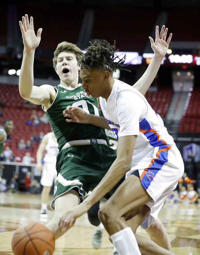 Colorado State's Adam Thistlewood (31) defends against a drive from Boise State's Derrick Alston during the first half of an NCAA college basketball game in the Mountain West Conference tournament, Wednesday, March 13, 2019, in Las Vegas. (AP Photo/Isaac Brekken)