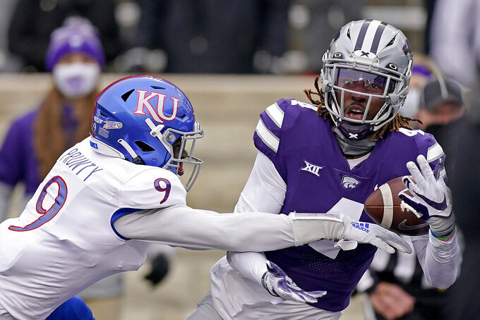 Kansas cornerback Karon Prunty (9) breaks up a pass intended for Kansas State wide receiver Malik Knowles (4) during the first half of an NCAA football game Saturday, Oct. 24, 2020, in Manhattan, Kan. (AP Photo/Charlie Riedel)
