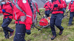 Volunteers from Wasdale mountain rescue team carry 121lb (55kg) St Bernard dog, Daisy from England's highest peak, Scafell Pike, Sunday July 26, 2020. The mountain rescue team spent nearly five hours rescuing St Bernard dog Daisy, who had collapsed displaying signs of pain in her rear legs and was refusing to move, while descending Scafell Pike. The Wasdale Mountain Rescue team rely on public contributions to their JustGiving.com/wasdalemrt page to fund their mountain safety efforts. (Wasdale Mountain Rescue via AP)