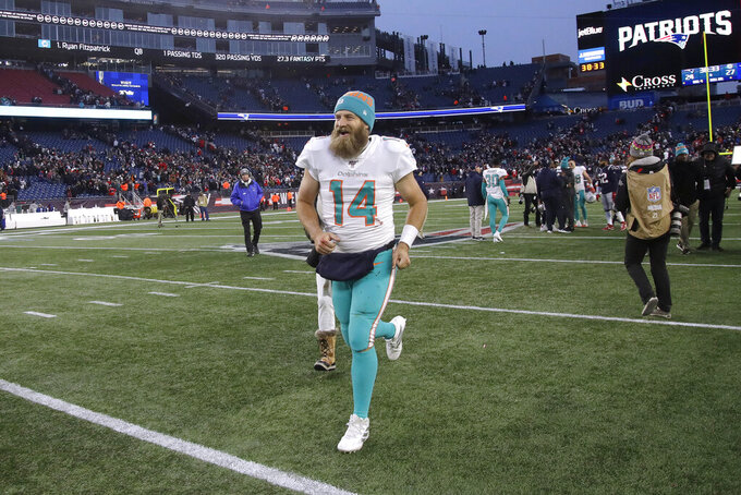 Miami Dolphins quarterback Ryan Fitzpatrick leaves the field after defeating the New England Patriots in an NFL football game, Sunday, Dec. 29, 2019, in Foxborough, Mass. (AP Photo/Elise Amendola)