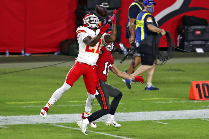 CORRECTS TO CHIEFS CORNERBACK BASHAUD BREELAND NOT RASHAD FENTON - Kansas City Chiefs cornerback Bashaud Breeland, left, intercepts a pass intended for Tampa Bay Buccaneers wide receiver Scott Miller (10) during the second half of an NFL football game Sunday, Nov. 29, 2020, in Tampa, Fla. (AP Photo/Mark LoMoglio)
