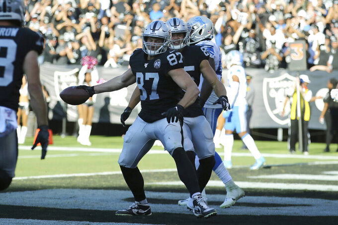 Oakland Raiders tight end Foster Moreau (87) celebrates after scoring against the Detroit Lions during the second half of an NFL football game in Oakland, Calif., Sunday, Nov. 3, 2019. (AP Photo/John Hefti)