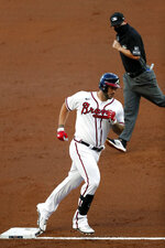 Atlanta Braves' Matt Adams (18) rounds third base after hitting a home run in the second inning of a baseball game against the Toronto Blue Jays Tuesday, Aug. 4, 2020, in Atlanta. (AP Photo/John Bazemore)