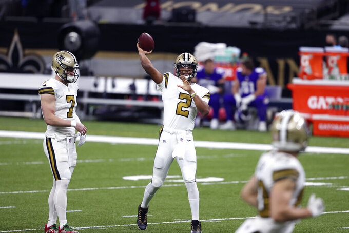 New Orleans Saints quarterback Jameis Winston (2) warms up before an NFL football game against the Minnesota Vikings in New Orleans, Friday, Dec. 25, 2020. (AP Photo/Butch Dill)