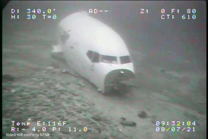 In this July 8, 2021 image from video provided by Sea Engineering, Inc. via the National Transportation Safety Board, the jet cabin from Transair Flight 810 rests on the Pacific Ocean floor off the coast of Honolulu, Hawaii. The Federal Aviation Administration said Friday, July 16,  that it will bar Rhoades Aviation of Honolulu from flying or doing maintenance inspections until it meets FAA regulations. The decision to ground the carrier, which operates as Transair, is separate from the investigation into the July 2 ditching of a Boeing 737, the FAA said.  (Sea Engineering, Inc./NTSB via AP)