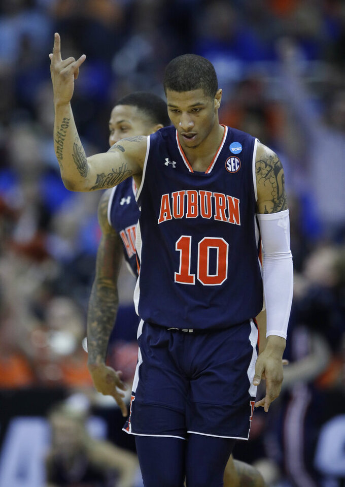 Auburn's Samir Doughty celebrates during the second half of a men's NCAA tournament college basketball Midwest Regional semifinal game against North Carolina Friday, March 29, 2019, in Kansas City, Mo. (AP Photo/Orlin Wagner)
