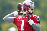 New England Patriots quarterback Cam Newton throws a pass during an NFL football practice, Friday, July 30, 2021, in Foxborough, Mass. (AP Photo/Elise Amendola)