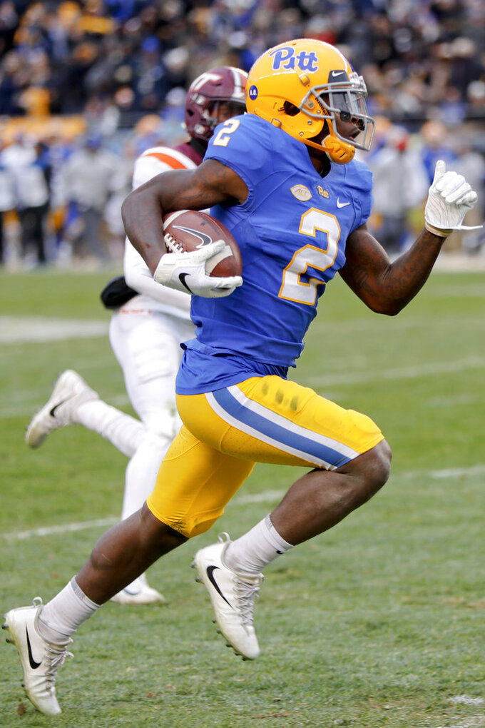 Pittsburgh wide receiver Maurice Ffrench (2) dashes for a touchdown past Virginia Tech defensive back Jermaine Waller (28) after making a catch in the second quarter of an NCAA football game, Saturday, Nov. 10, 2018, in Pittsburgh. (AP Photo/Keith Srakocic)
