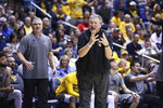 FILE - West Virginia coach Bob Huggins reacts during the first half of an NCAA college basketball game against Baylor in Morgantown, W.Va., in this Saturday, March 7, 2020, file photo. West Virginia opens the 2020-21 season ranked No. 15 in the AP poll and returns four of the top five scorers from the team that went 21-10 last season. (AP Photo/Kathleen Batten, FIle)