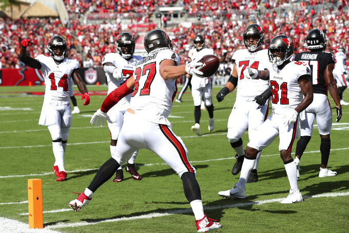 Tampa Bay Buccaneers tight end Rob Gronkowski (87) spikes the football after catching a 20-yard touchdown pass from quarterback Tom Brady (12) during the first half of an NFL football game against the Atlanta Falcons Sunday, Sept. 19, 2021, in Tampa, Fla. (AP Photo/Mark LoMoglio)