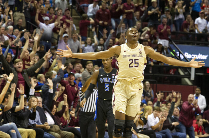 Florida State forward Mfiondu Kabengele and the fans celebrate Savoy's 3-point shot in the first half of an NCAA college basketball game against Duke in Tallahassee, Fla., Saturday, Jan. 12, 2019. (AP Photo/Mark Wallheiser)
