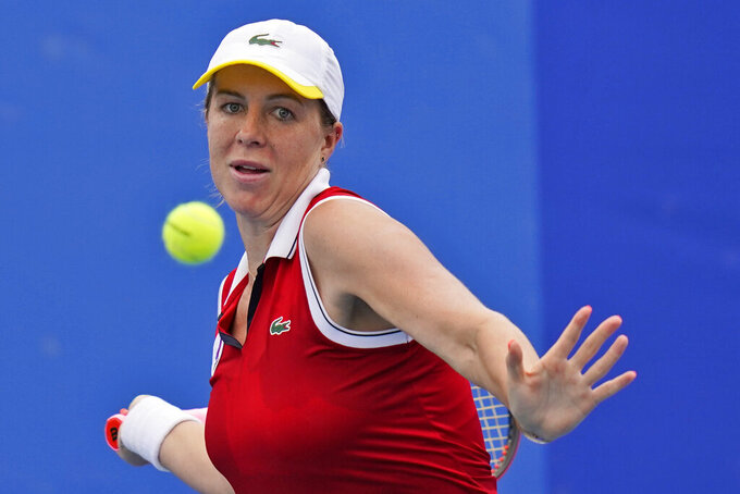 Anastasia Pavlyuchenkova, of the Russian Olympic Committee, plays against Anna-Lena Friedsam, of Germany, during the second round of the tennis competition at the 2020 Summer Olympics, Monday, July 26, 2021, in Tokyo, Japan. (AP Photo/Seth Wenig)